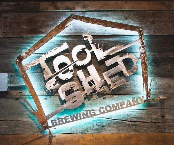 Tool shed brewing company logo Olympia Benefits